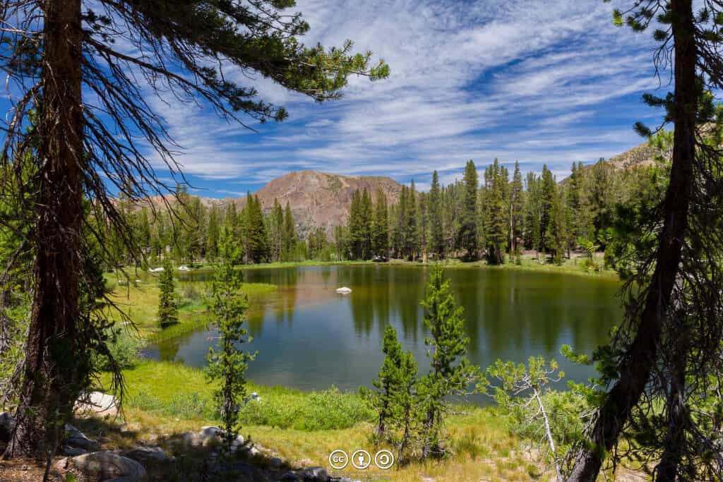 A blue-sky view of a High Sierra pond by au_ears on Flickr