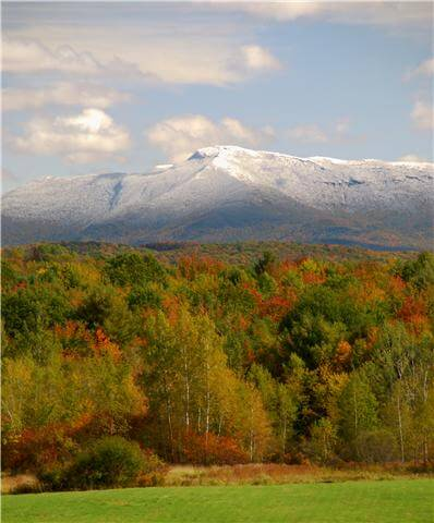 A view of Mt. Mansfield covered with snow during Vermont fall foliage season