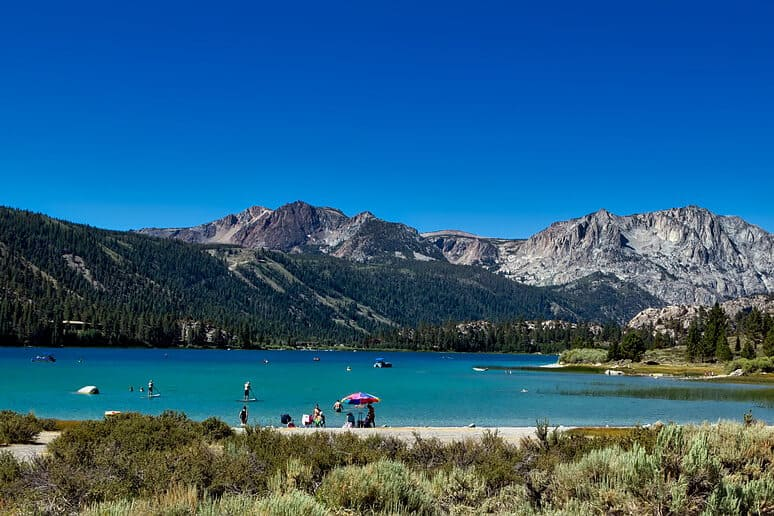 June Lake in the summer with mountains in the background.