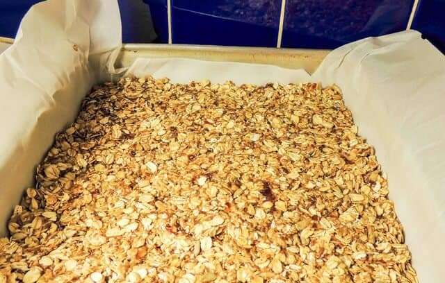 A pan of granola bars, ready to be cut and devoured.