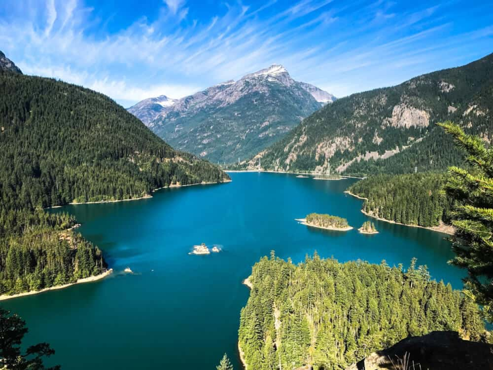 a view of a deep blue lake surrounding by mountains in North Cascades National Park