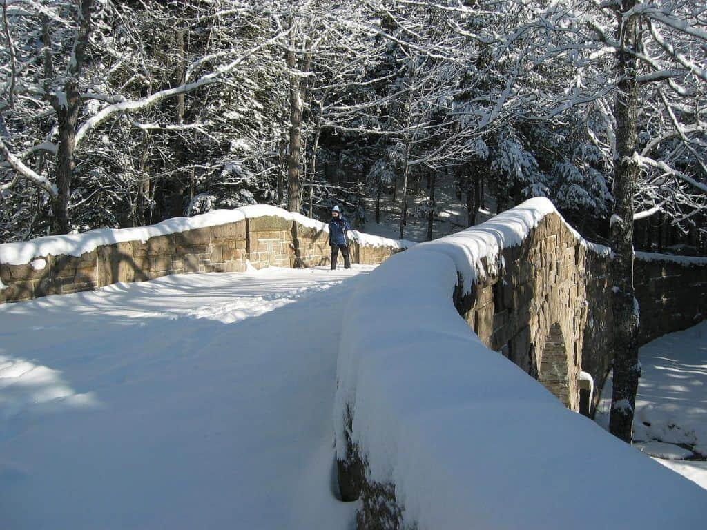 A person cross-country skiing on the carriage roads in Acadia National Park.