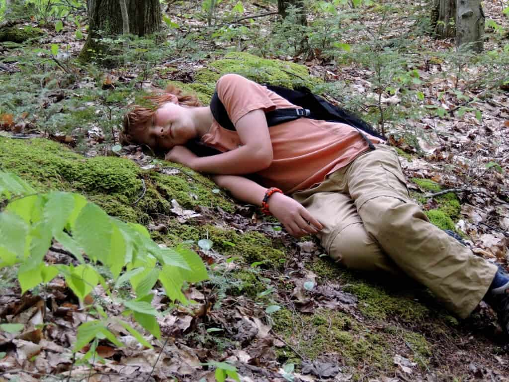 A child takes an afternoon nap in the woods of Vermont.