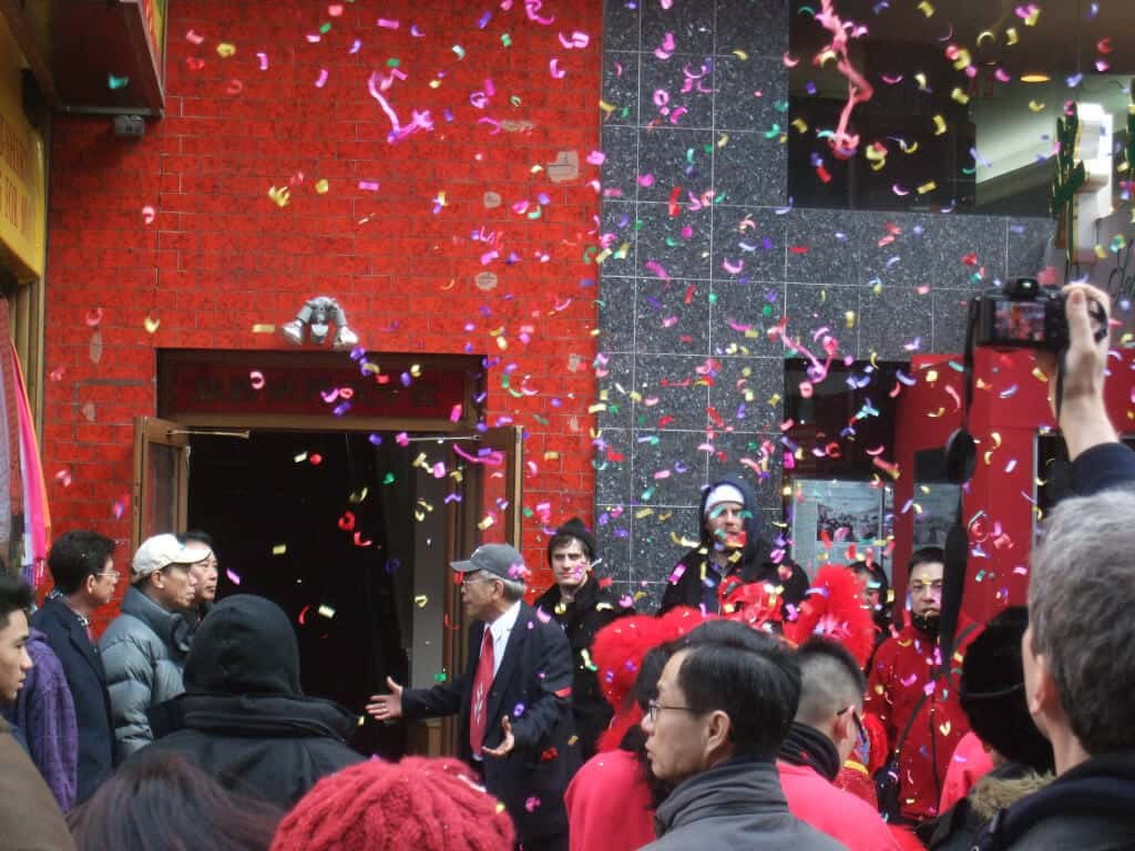Colorful confetti flies during Chinese New Year in New York City.