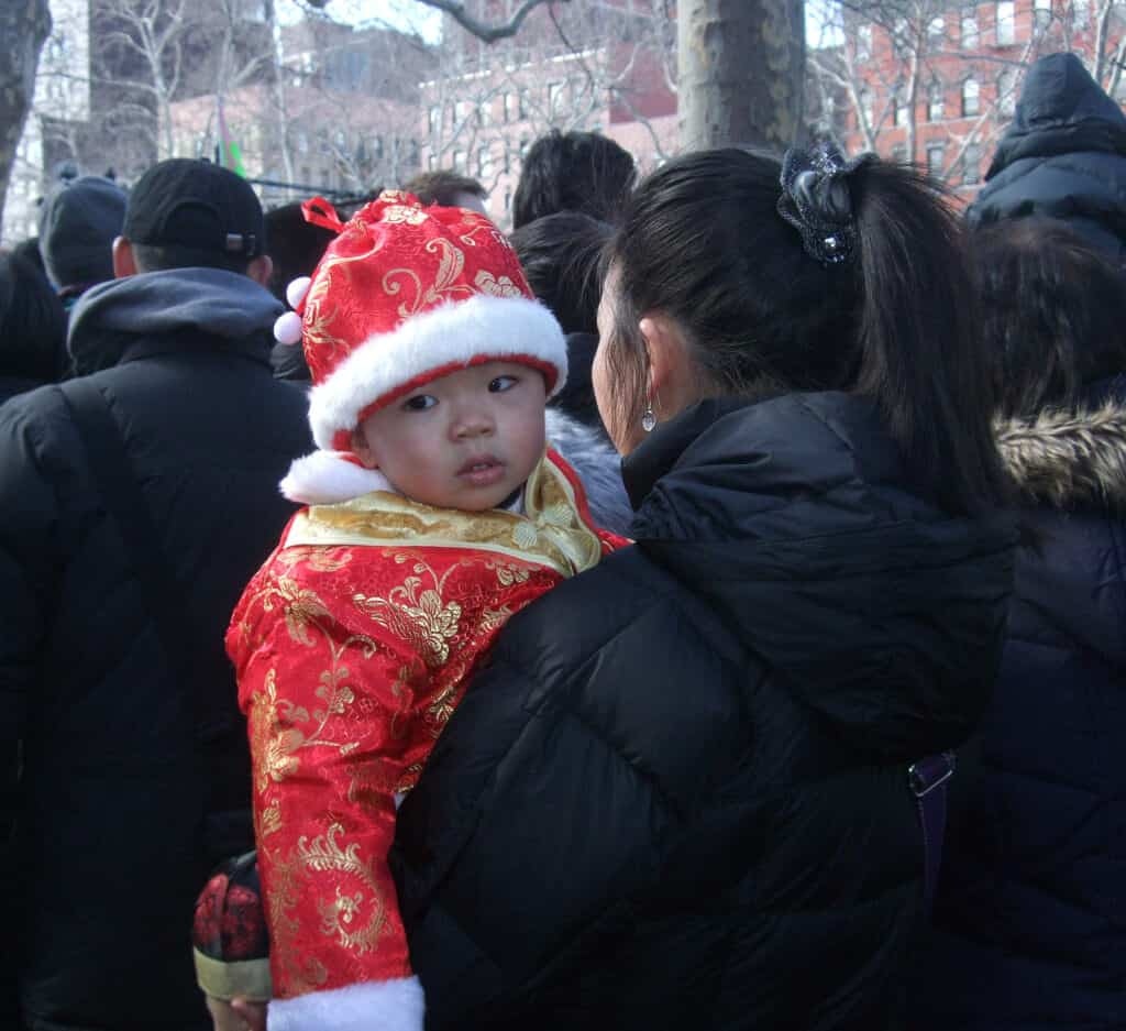 A mother and child celebrating Chinese New Year in Manhattan.