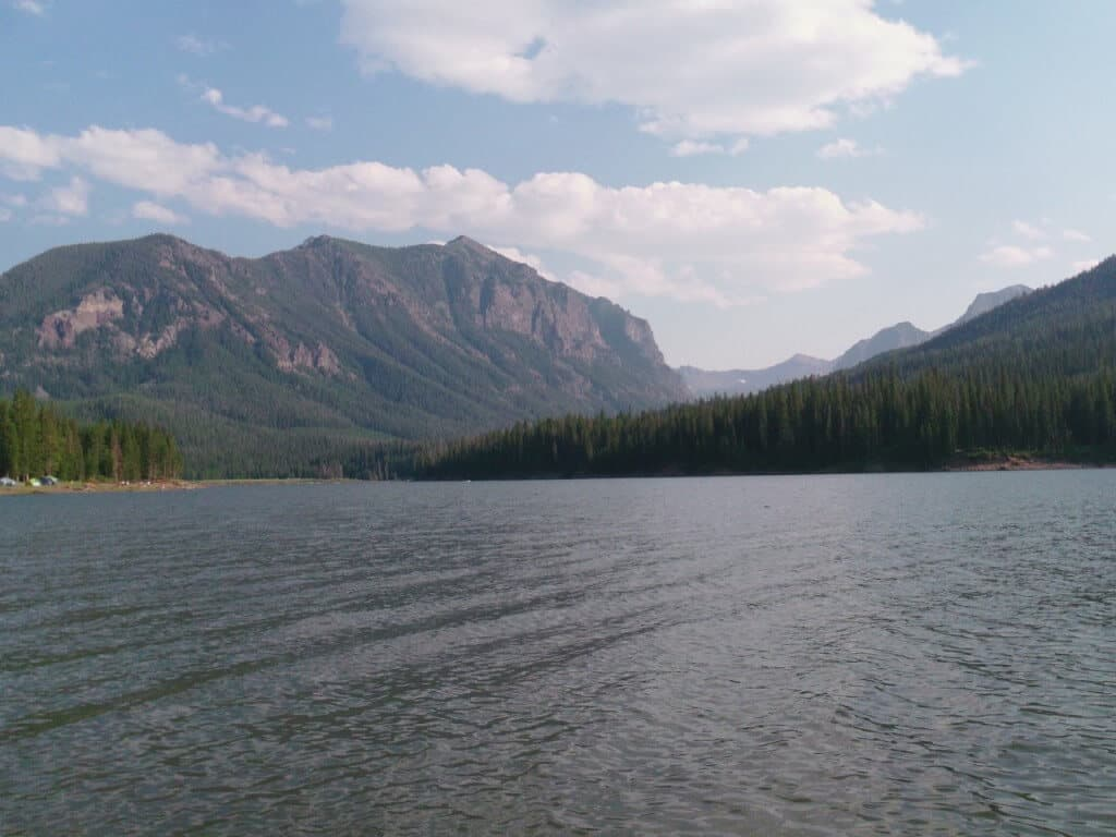 A huge lake flocked by mountains in Bozeman, Montana