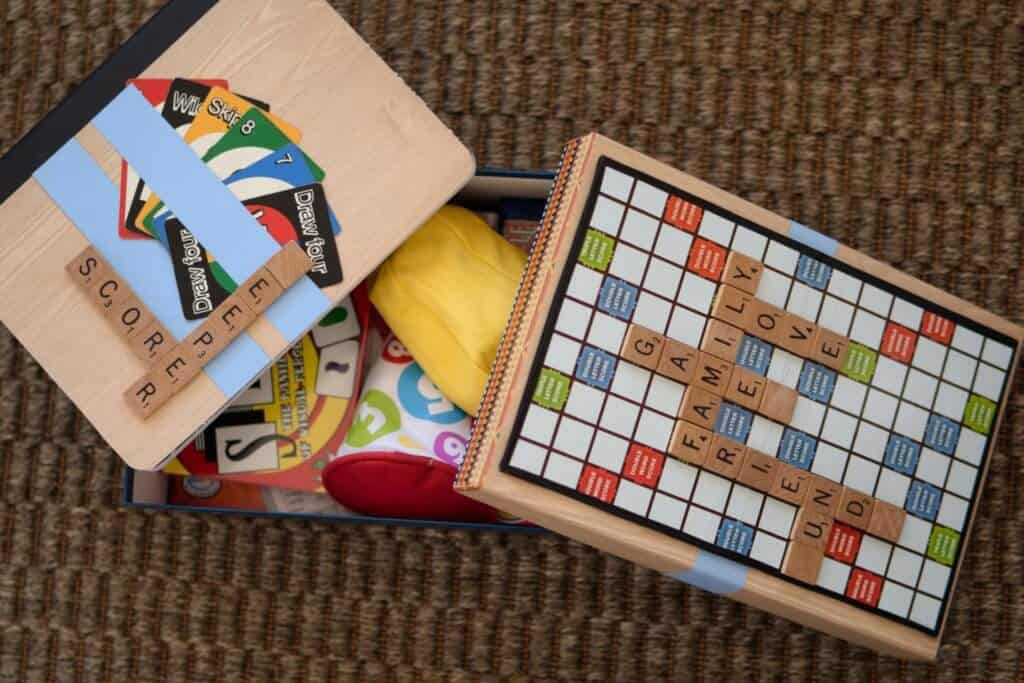 a homemade game box with a scrabble theme.