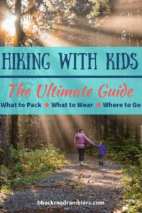 A woman walks through the woods with a young girl. Caption reads: Hiking with Kids: The Ultimate Guide