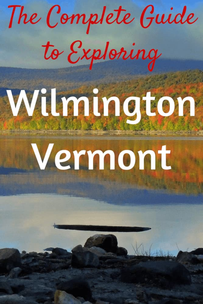A fall scene of Lake Whitingham in Wilmington, Vermont. Caption reads: The Complete Guide to Exploring Wilmington, Vermont.