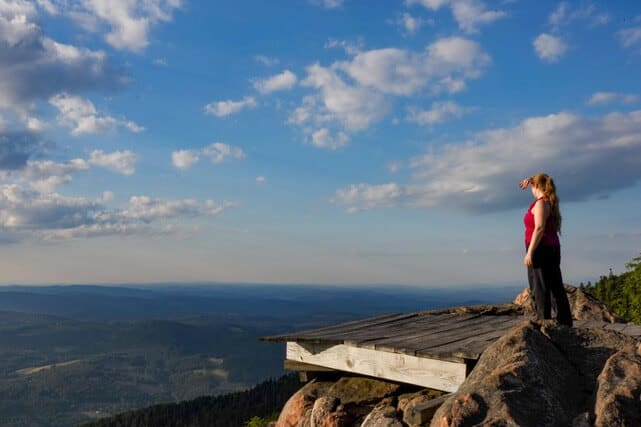A hiker checks out the view from the hang gliding platform of the summit of Mt. Ascutney.