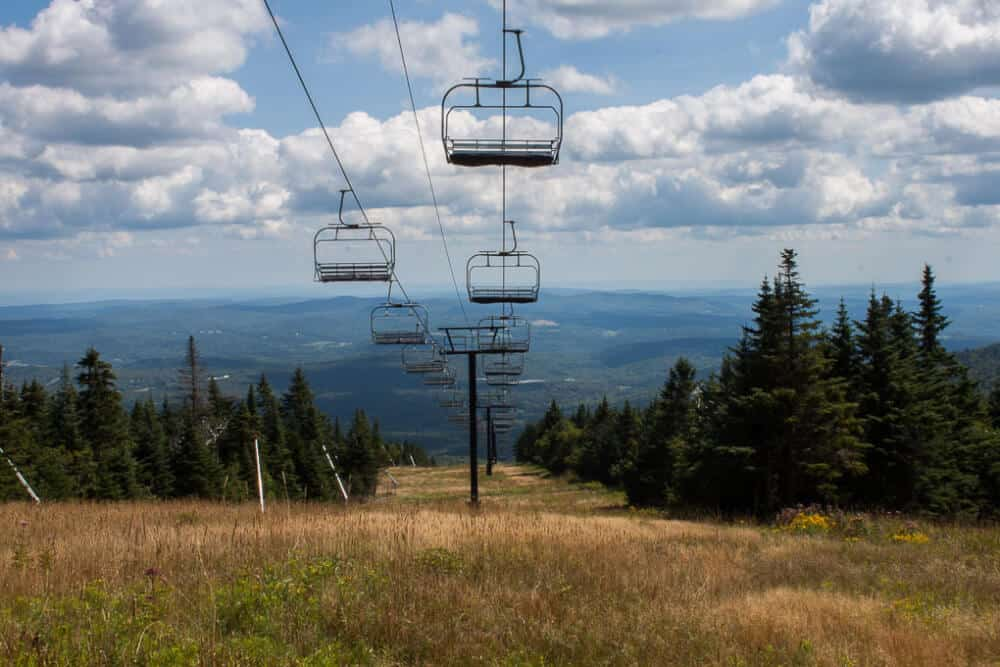 A view of the Bluebird Express chairlift on Mount Snow from one of the hiking trails in the summer.