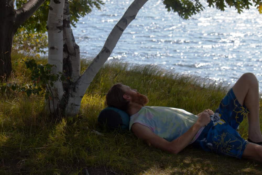 Eric relaxing in the grass at Woods Island State Park