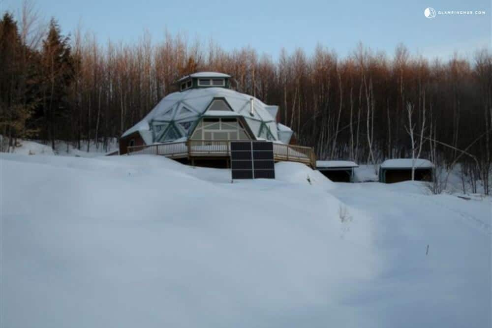A geodesic dome in Vermont surrounded by snow.