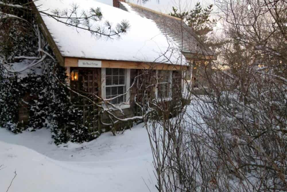 A beautiful little cottage surrounded by snow in Truro, MA
