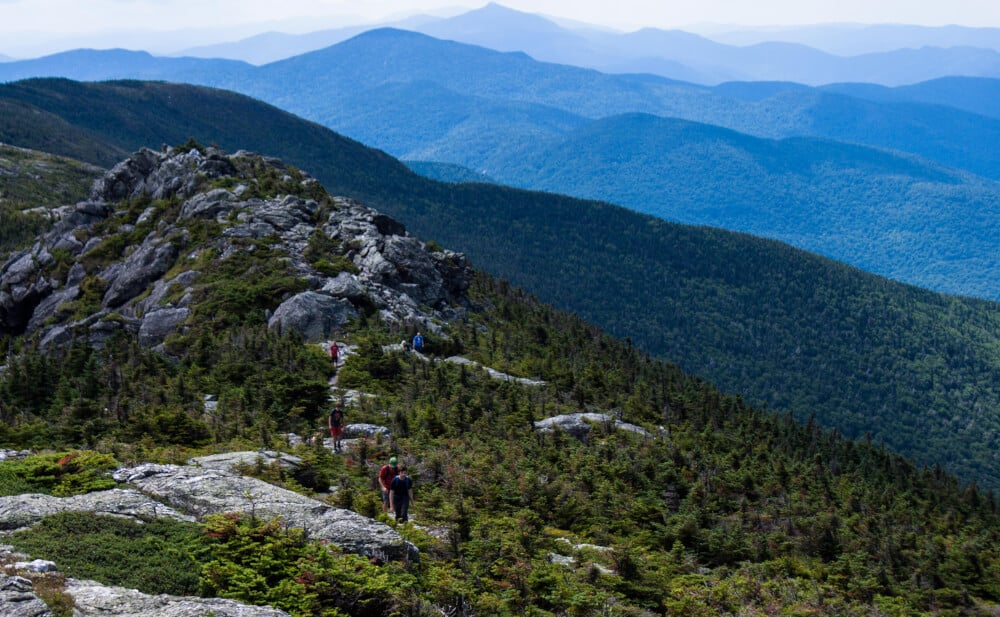 A group of hikers walks along the ridge of Mt. Mansfield in Stowe, Vermont.