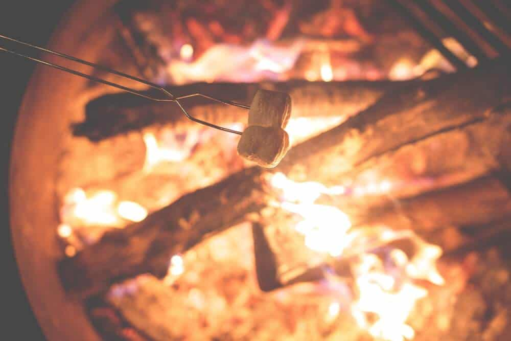 roasting s'mores over a campfire.