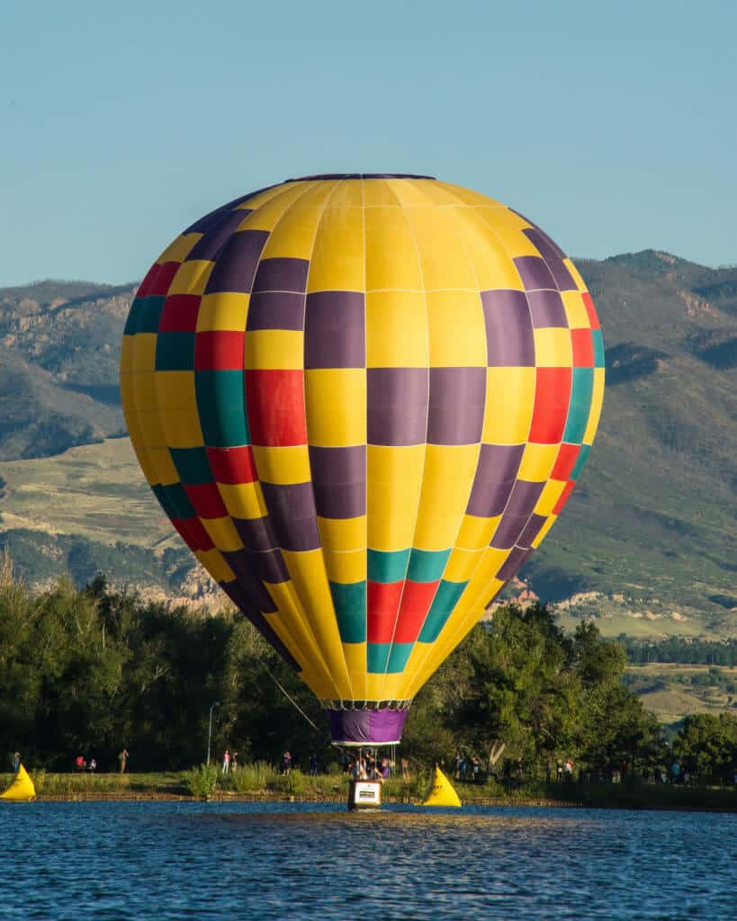 A single colorful hot air balloon at the Colorado Springs Labor Day Lift Off