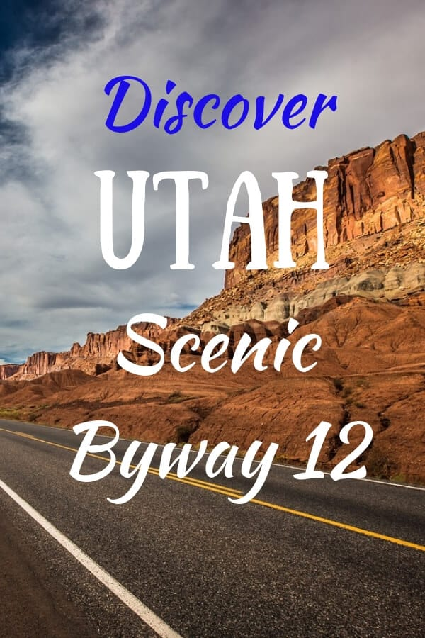 A scene of scenic byway 12 in Utah with red cliffs and cloudy skies.