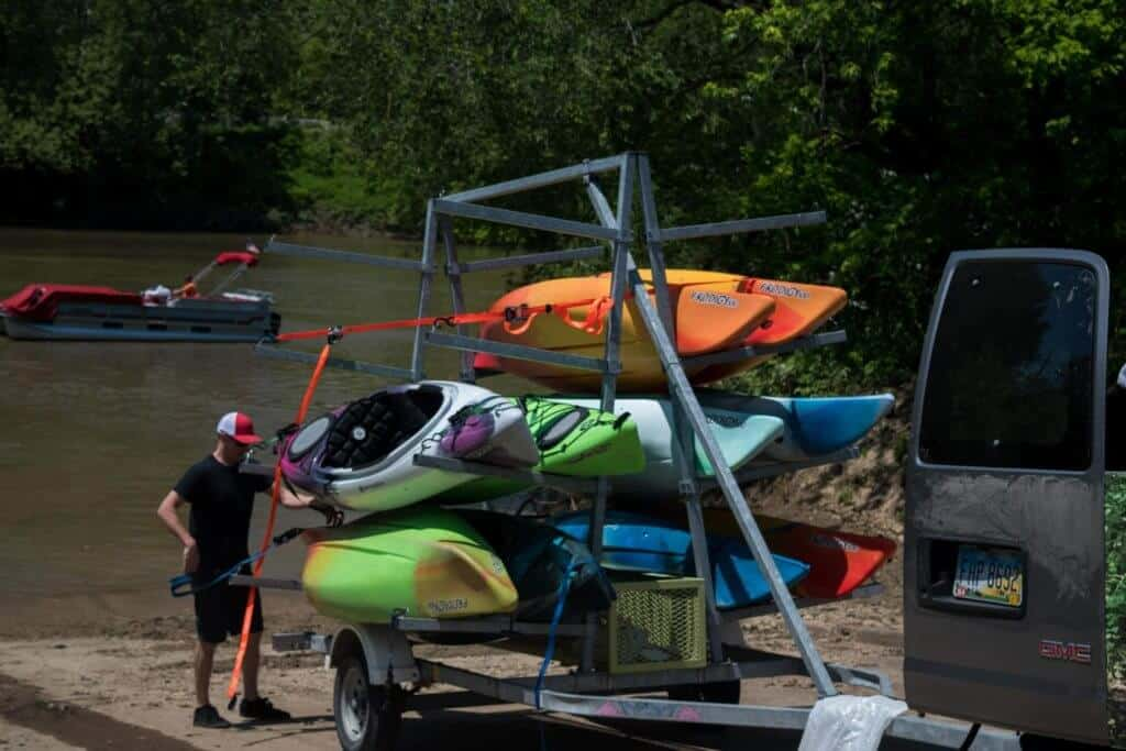 A man unloads kayaks from a trailer in Marietta, Ohio.