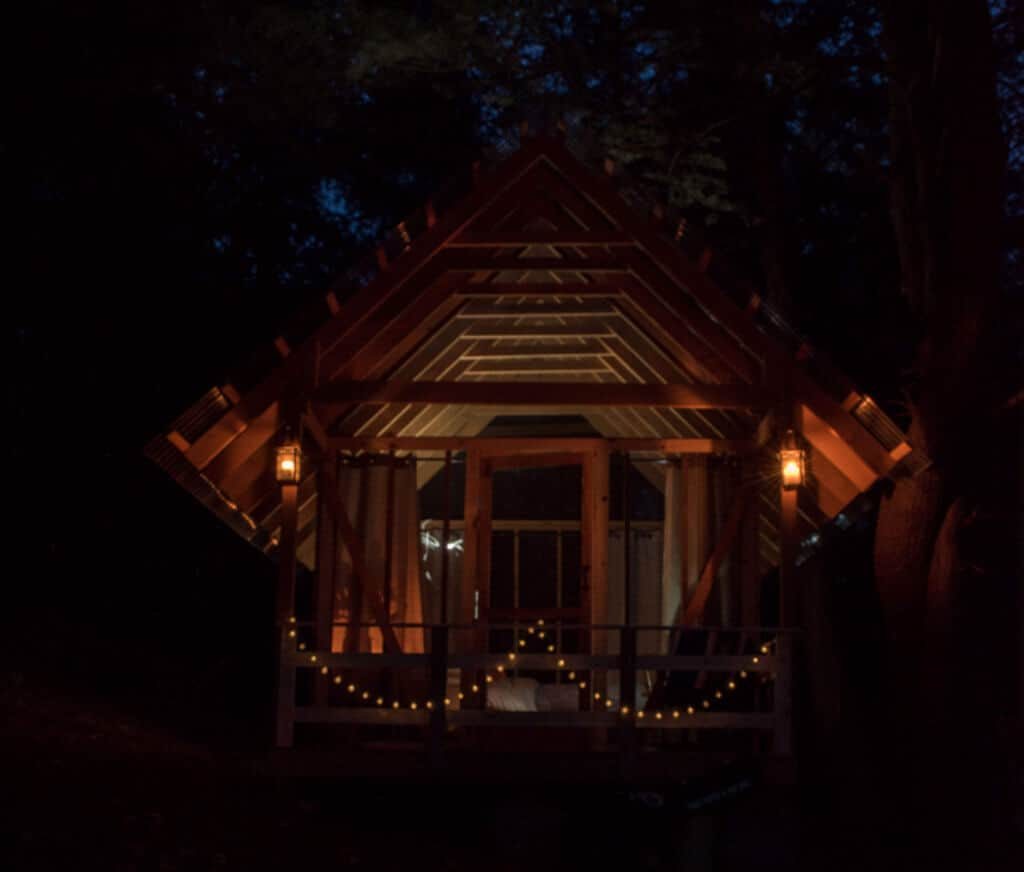 The open-air cabin at Tanglebloom Farm in Vermont at night.