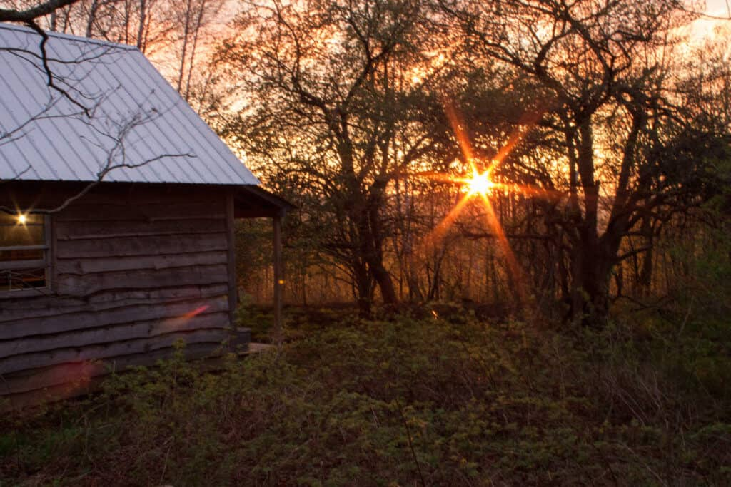 A cabin for rent in Vermont during the sunset.