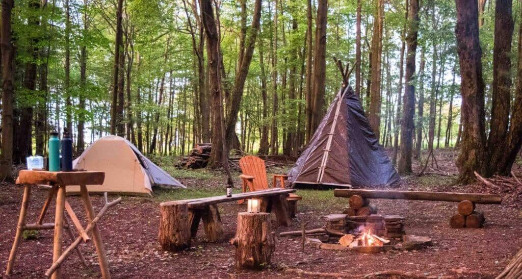 A tipi, tent and fire pit in Newfield, NY
