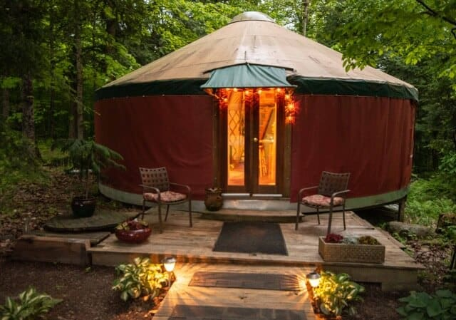 a nighttime view of a yurt for rent in Vermont.
