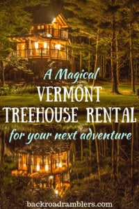 A night view of our Vermont treehouse rental. Caption reads: A Magical Vermont Treehouse Rental for your next adventure