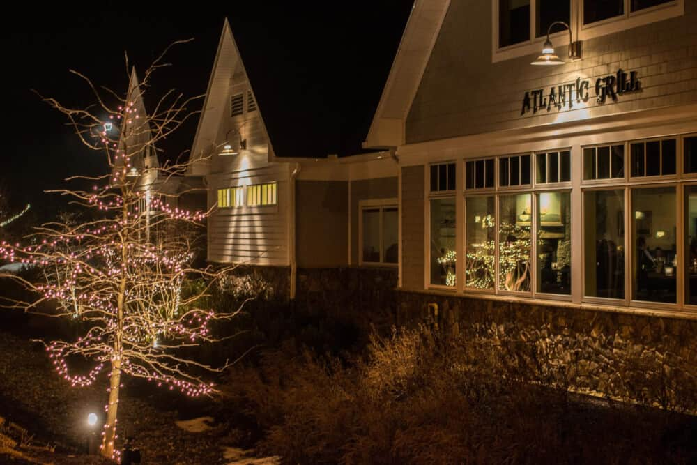 The outside of the Atlantic Grill in Rye, New Hampshire at night.