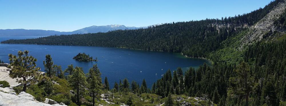 A deep blue lake surrounded by mountains at Emerald Bay State Park