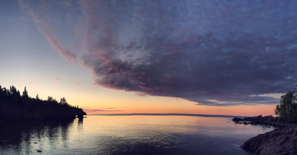 sunset over a peaceful Minnesota lake - Tettegouche State Park