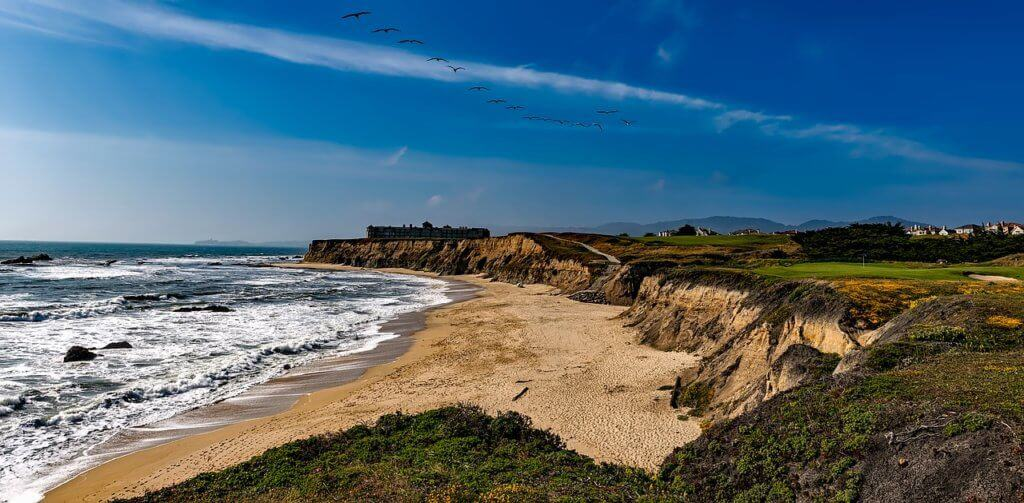 A wide landscape view of Half Moon Bay in the Bay Area of California.