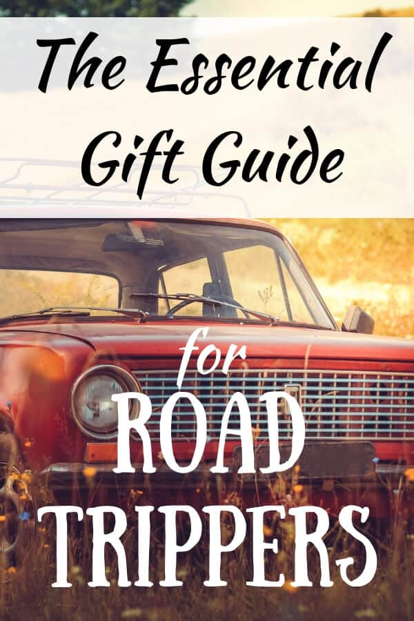 A red car in a field with a caption: The essential gift guide for road trippers