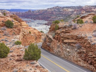 A winding road through the red rocks on Highway 12 in Utah.