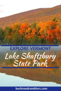 Fall foliage reflections on Lake Shaftsbury in Vermont. Caption reads: Explore Vermont: Lake Shaftsbury State Park