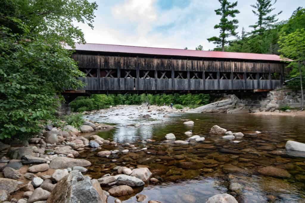 A view of the Albany Covered Bridge in the White Mountains as seen from the Swift River