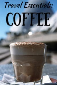 A cup of coffee with the caption: Travel Essentials - coffee