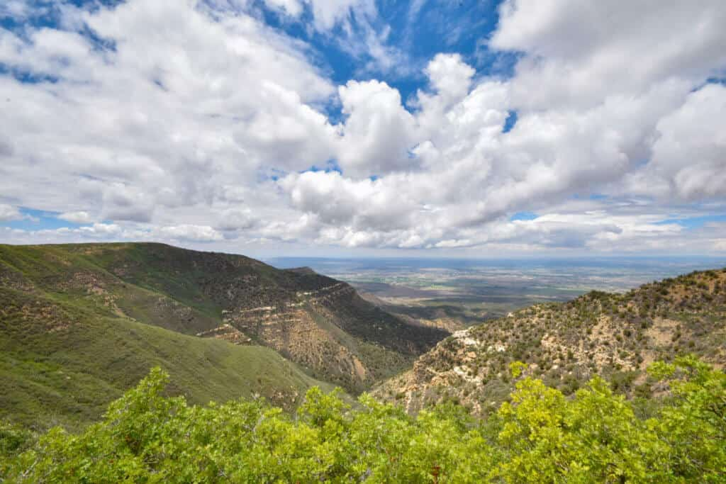 A distant view of mountains, valleys, and mesas in Mesa Verde National Park