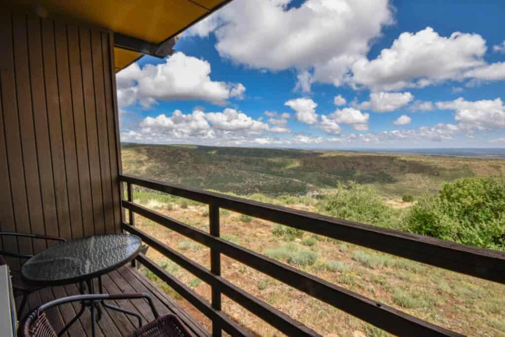balcony view at far view lodge - mesas and cloudy skies