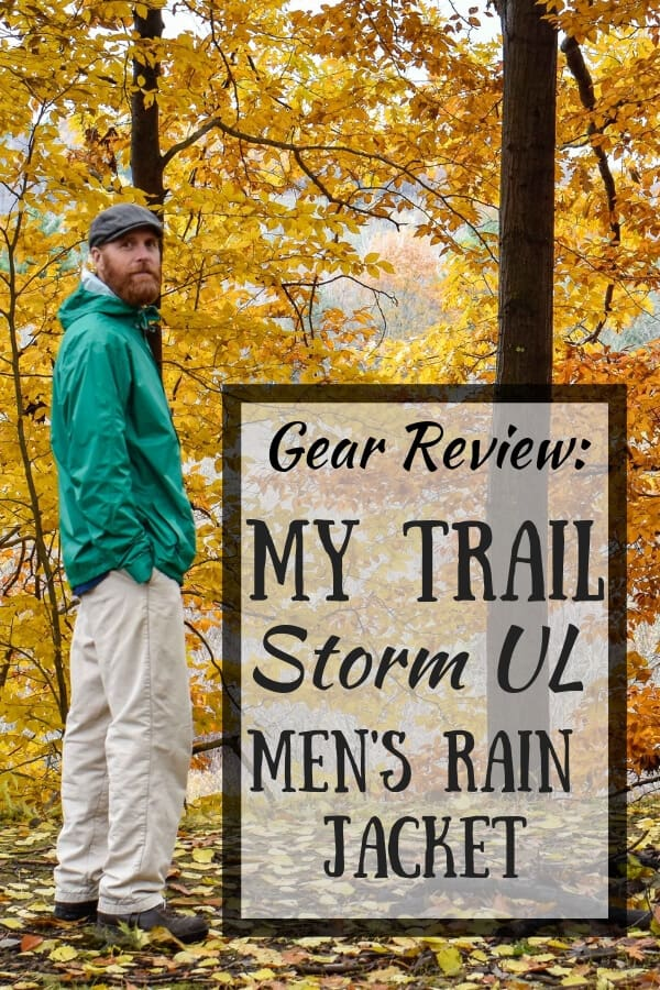 A men stands in the woods wearing a green raincoat. Caption reads: Gear review: My Trail Storm UL Men's Rain Jacket