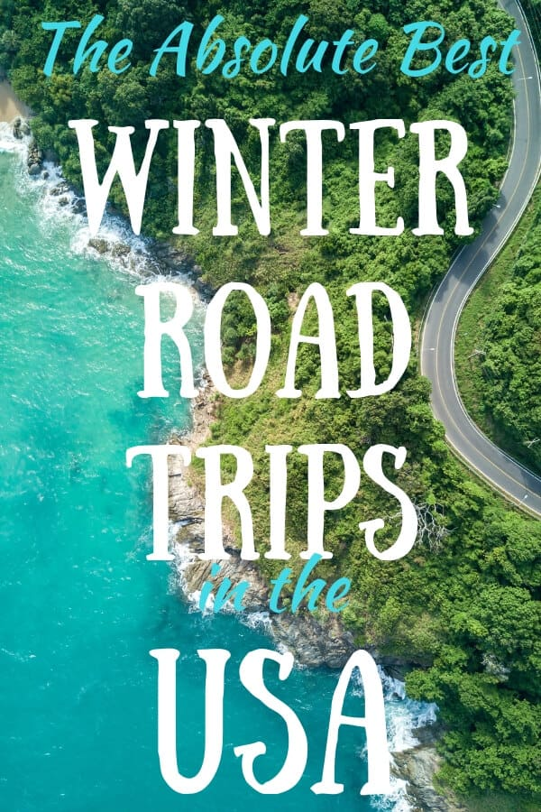An aerial view of a road near the ocean. Caption reads: The Absolute Best Winter Road Trips in the USA.