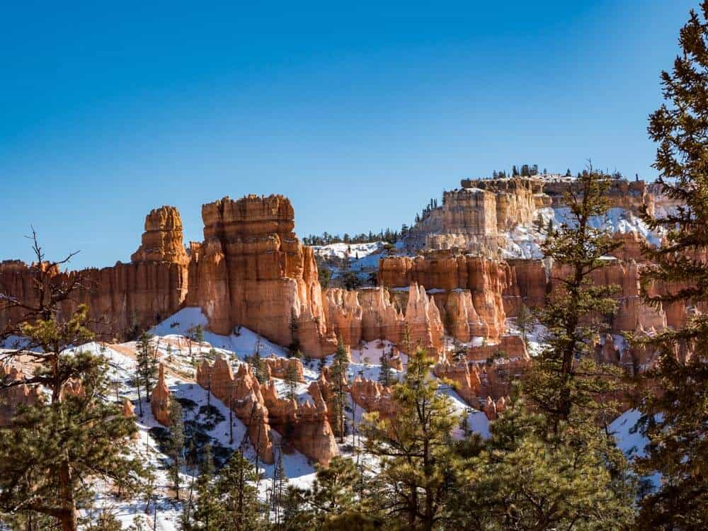 The voodoos in Bryce Canyon during the winter. They are dusted with snow.