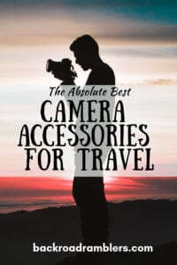 A silhouette of a man in the sunset holding a camera, with the caption: The Absolute Best Camera Accessories for Travel.