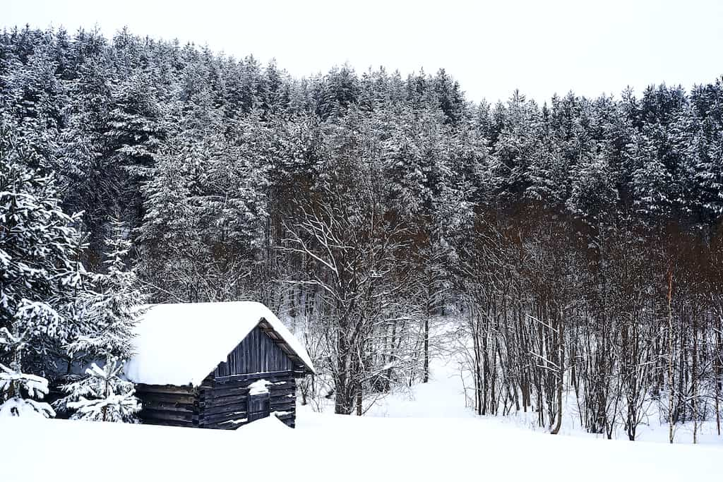 A cabin covered with snow in New England