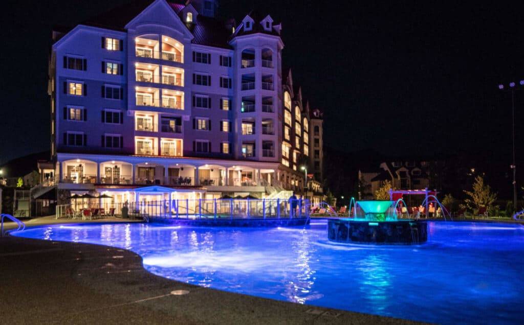 a night time view of the swimming pool at RiverWalk Resort at Loon Mountain