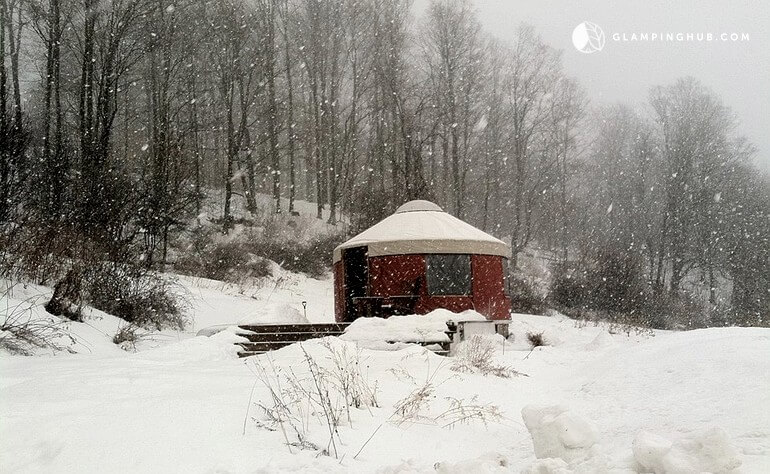 Winter view of a yurt rental in Waterville, New York