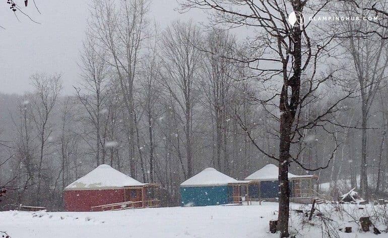 Several yurts in the snow in upstate New York