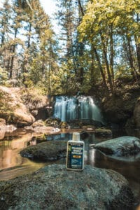 Picaridin lotion from Sawyer in front of a waterfall.