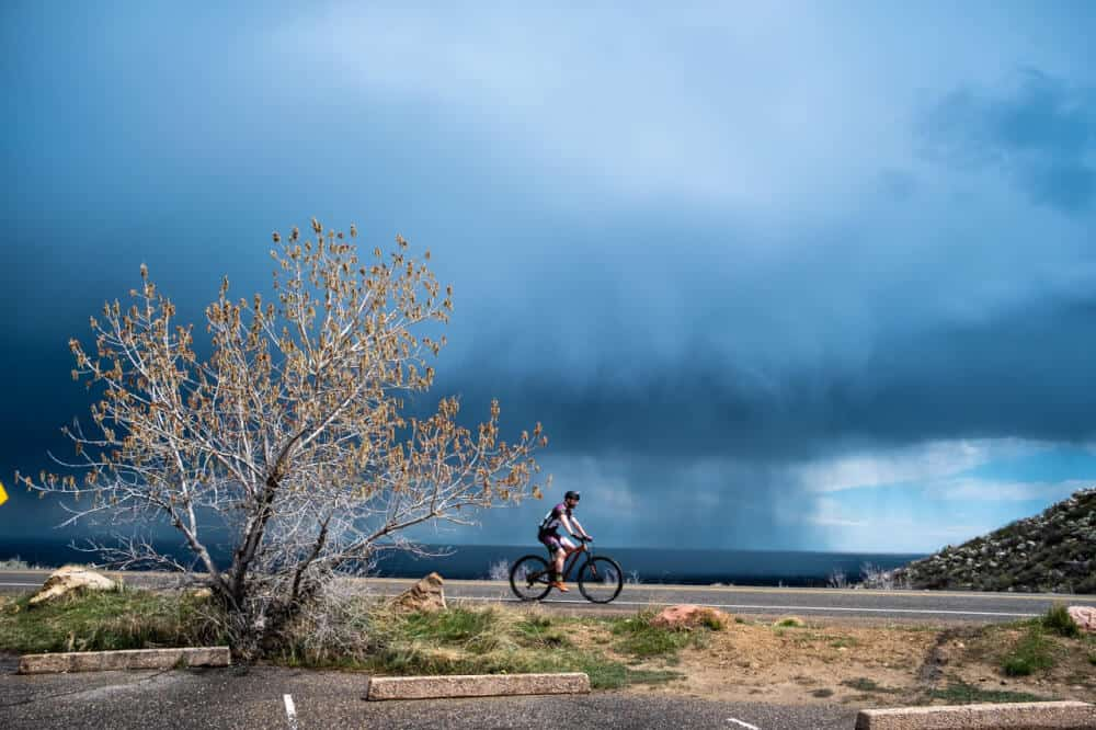 A lone bicycle rides through the Horsetooth Reservoir in Fort Collins, Colorado before a storm.