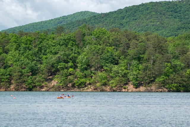Two kayakers enjoying Carvins Cove Reservoir in Roanoke, VA.